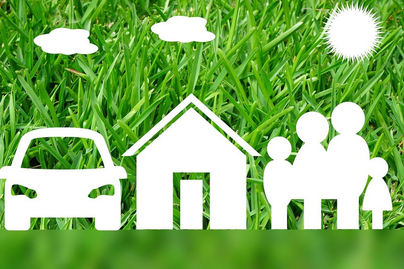 Car, home, family image on green background